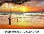 empty swing at sunset beach | Shutterstock . vector #256043725
