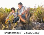 father and son hiking in the... | Shutterstock . vector #256070269