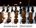 the chess pieces on a table in... | Shutterstock . vector #256116265