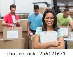 smiling young female volunteer... | Shutterstock . vector #256121671