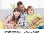 happy father tickling children...   Shutterstock . vector #256175305