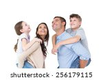 happy parents giving piggyback... | Shutterstock . vector #256179115