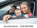 parents and baby on a drive in... | Shutterstock . vector #256184584