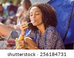 carefree hipster blowing... | Shutterstock . vector #256184731