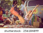 Small photo of Carefree hipster having fun on campsite at a music festival