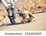 Builder Worker At Sand Ground...