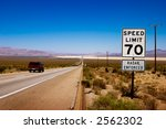 desert highway to horizon with... | Shutterstock . vector #2562302
