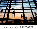 washers wash the windows of... | Shutterstock . vector #256236991