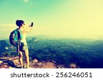 woman hiker taking photo with... | Shutterstock . vector #256246051