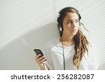 teenage girl in headphones... | Shutterstock . vector #256282087