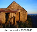 Old barn in the winter sun - stock photo
