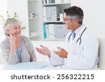 happy male doctor discussing... | Shutterstock . vector #256322215