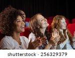 young friends watching a film... | Shutterstock . vector #256329379