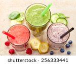 glasses of various smoothies... | Shutterstock . vector #256333441