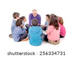 teacher telling a story to kids ... | Shutterstock . vector #256334731