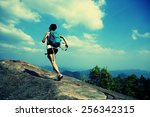young asian woman hiker running ... | Shutterstock . vector #256342315