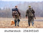 Two Hunters And Dog On The Field