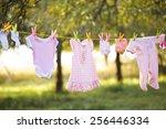 Stock photo pink baby wear outdoor in garden 256446334