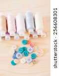 threads and  colorful buttons ... | Shutterstock . vector #256608301