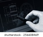 designer working on a cad... | Shutterstock . vector #256608469