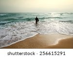 surfer at the sea is standing... | Shutterstock . vector #256615291