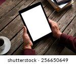 man shows screen of digital...   Shutterstock . vector #256650649