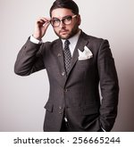 elegant young handsome man in...   Shutterstock . vector #256665244