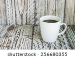 White Coffee Mug On Wood...