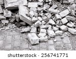 Bricks And Rubble On A Cobbled...