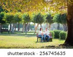 Smiling Family In Autumn Park....