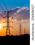 silhouette of high voltage... | Shutterstock . vector #256858327