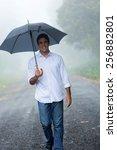 Happy Man With Umbrella Walkin...