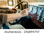 driver hands holding steering...   Shutterstock . vector #256894747