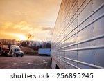 truck trailers in sunset | Shutterstock . vector #256895245