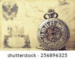 vintage clock on antique map.... | Shutterstock . vector #256896325