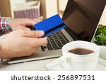 man holding credit card and... | Shutterstock . vector #256897531