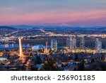 Small photo of Portland Oregon South Waterfront with Ross Island Bridge Mount Hood Along Willamette River during Alpenglow Sunset