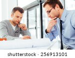 two male architects deep in... | Shutterstock . vector #256913101