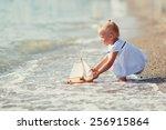 a cute little girl in white... | Shutterstock . vector #256915864