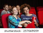 young couple watching a film at ... | Shutterstock . vector #257069059