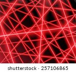red laser beams on a black...
