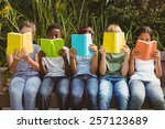 children sitting in row and... | Shutterstock . vector #257123689