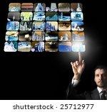 A young businessman selecting a destination - stock photo