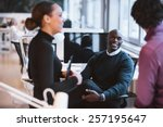 happy african man sitting at... | Shutterstock . vector #257195647