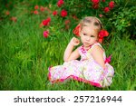 cute baby in the park among the ... | Shutterstock . vector #257216944