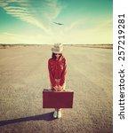 woman traveler holds vintage... | Shutterstock . vector #257219281