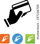 Hand holding a credit card. Symbol for download. Vector icons for video, mobile apps, Web sites and print projects.  | Shutterstock vector #257236705