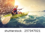 young lady paddling hard the... | Shutterstock . vector #257347021