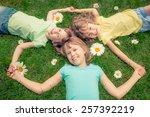 happy children lying on grass.... | Shutterstock . vector #257392219