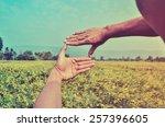 hands framing distant | Shutterstock . vector #257396605